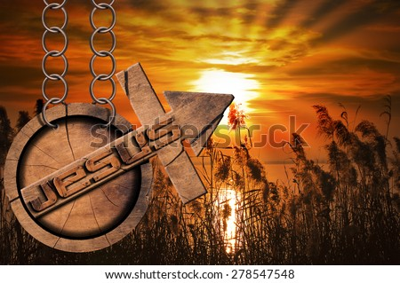 Jesus Wooden Symbol with Cross at the Sunset. Wooden symbol with cross and arrow upward and text Jesus. Hanging from a chain at a beautiful sunset over the lake with cloudy sky - stock photo