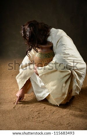 Jesus writing with finger in the sand