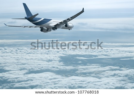 Jet above the clouds - stock photo
