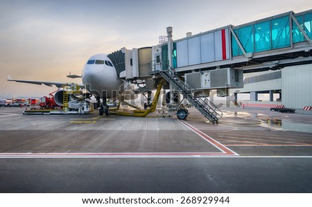 Jet aircraft docked in Dubai International Airport - stock photo