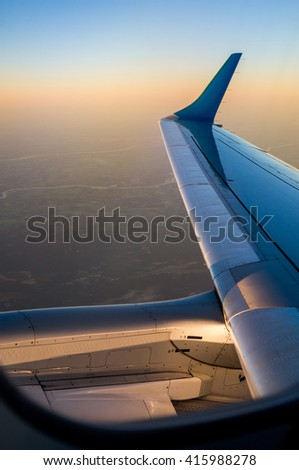 Jet Aircraft Winglet (Wingtip) and Engine after take off from Amsterdam Shiphol Airport (North Holland, The Netherlands). - stock photo