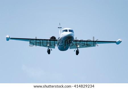 Jet airliner in flight ready for landing - stock photo