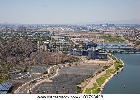 Jet Airliner on approach over Tempe to Sky Harbor International Airport in Phoenix, Arizona - stock photo
