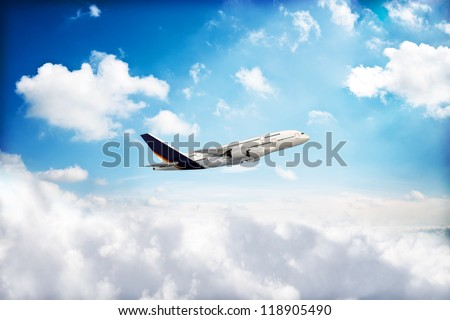 Jet airplane peaking through the clouds