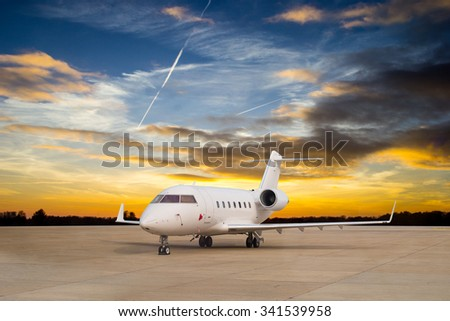 Jet airplane stop for wait VIP passenger on runway.