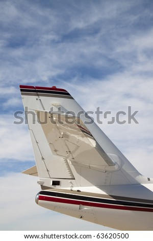 Jet Airplane Tail The tail section of a private jet airplane. Vertical. - stock photo