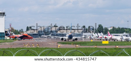 Jet Airplanes at the airfield in International Airport Kyiv (IEV). Kyiv, Ukraine - June 5, 2016