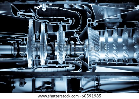 jet engine cross section cutaway detail with a blue tint - stock photo