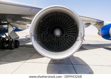Jet engine on the wing of an airplane on the runway