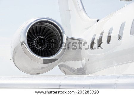 Jet Engine with a part of a wing on a luxury private aircraft  - stock photo