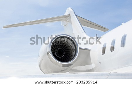 Jet Engine with a tail and part of a wing on a luxury private Jet Plane