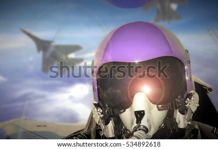 Jet fighter pilot cockpit view during sunrise