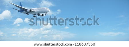 Jet in a blue sky. Panoramic composition.