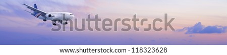 Jet is maneuvering in a morning sky. Panoramic composition. - stock photo