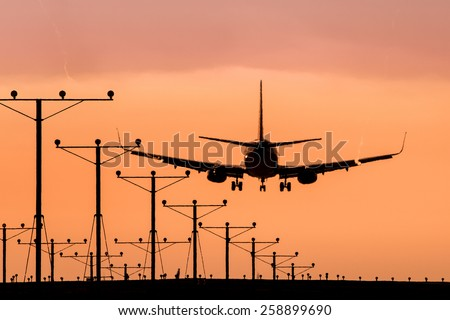 Jet Landing on a Runway - stock photo