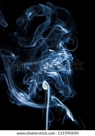 jet, monochrome clubs and curls of smoke, a photo on a dark background.