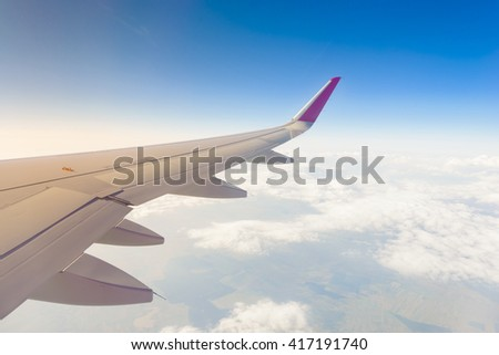Jet plane flying at high altitude - stock photo