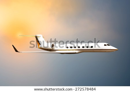 Jet plane flying with sunset sky background - stock photo