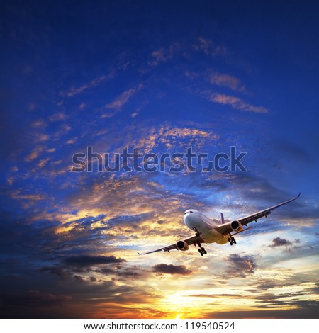Jet plane in a sunset sky. Square composition. - stock photo
