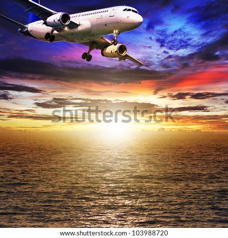 Jet plane over the sea at sunset time. Square composition. - stock photo