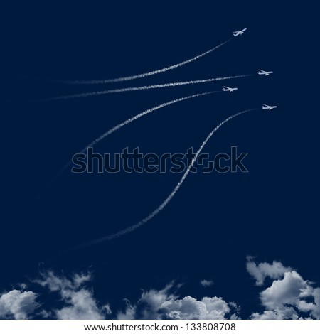 Jet plane trails in blue sky - clipart for sky image compositions - dark version for easy isolation