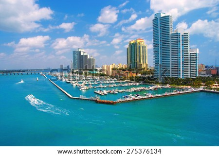 jet ski and boat sailing next to South Miami Beach - stock photo