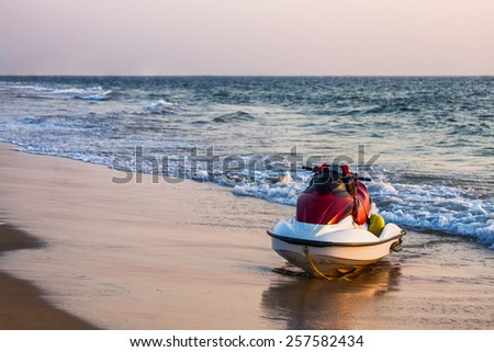 Jet ski on sea or ocean sand beach coast or shore - stock photo