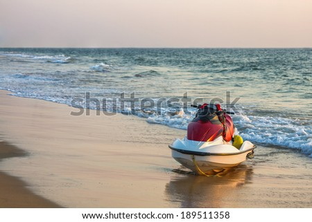 Jet ski on the beach near the ocean - stock photo
