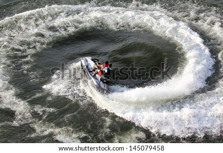 Jet ski team formed a circle in the water during the presentation. - stock photo