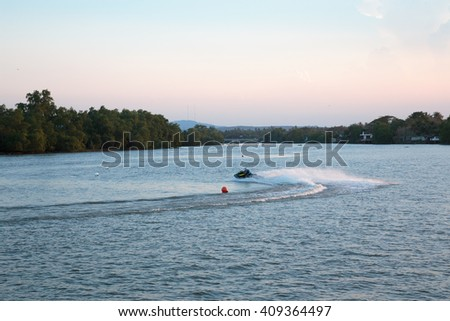 Jet skis and fun on the river. Various transportation and recreational activities during a holiday weekend.