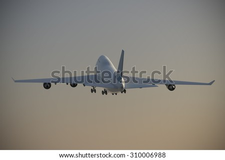 Jet takeoff at early morning.  A Jet takes off during the early morning hours towards a clear sky. - stock photo