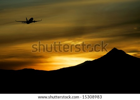 Jet taking off from Portland Oregon airport in front of Mt. Hood - stock photo