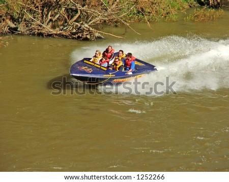 Jetboat with passengers - stock photo