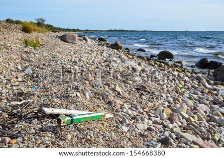 Jetsam at a rocky part of the coast of Baltic sea in Sweden - stock photo