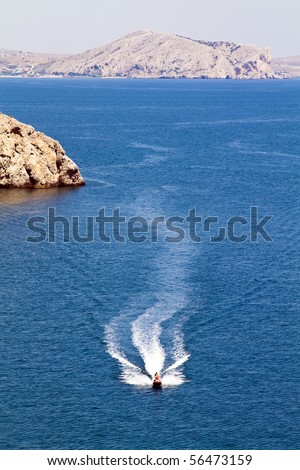 jetski racing on a blue water background - stock photo