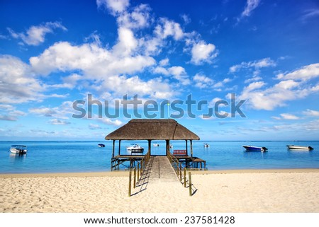 Jetty and boats at Mauritius beach - stock photo