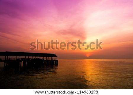 Jetty and sunset at Tioman Island, Malaysia - stock photo