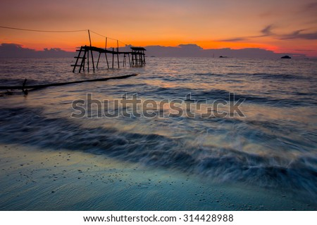 Jetty and sunset background  - stock photo