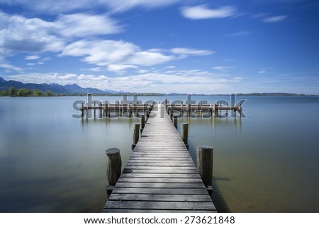"Jetty at lake ""Chiemsee"" in Bavaria, Germany. Shot taken with long exposure time.  - stock photo"