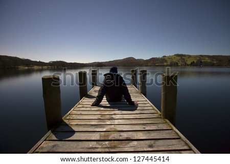jetty at night with man - stock photo
