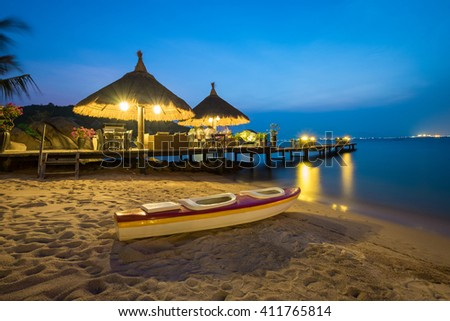 Jetty by night. Beautiful, clean and fresh beach with affordable accommodation for visitors and travelers. - stock photo