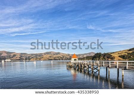 Jetty in Akaroa, on Akaroa Harbour, New Zealand. - stock photo