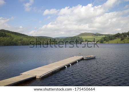 jetty in lake with beautiful countryside in the peak district, england - stock photo