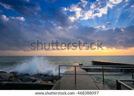 jetty in the morning with waves
