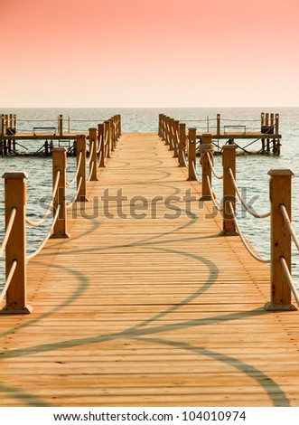 Jetty into the Sunrise - stock photo