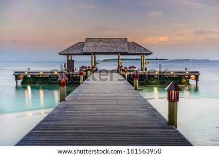 Jetty on a luxury resort in the Maldives - stock photo