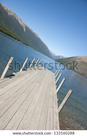 Jetty on Lake Rotoiti in the Nelson Lakes District with mountains, South Island, New Zealand. - stock photo
