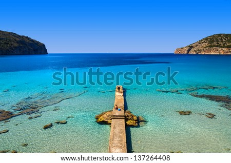 Jetty sea horizon beach bay mountains, Camp de Mar, Majorca island, Spain - stock photo