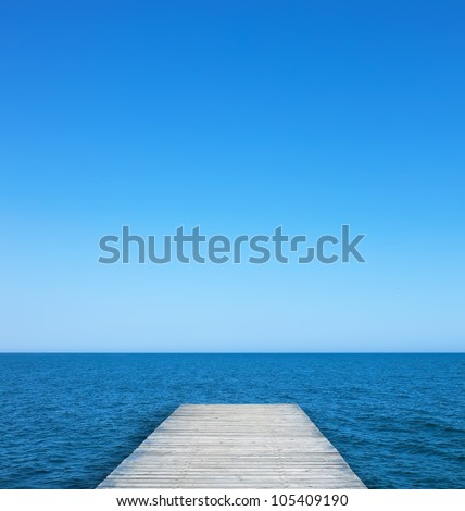 Jetty view to sea on the sunny summer day - stock photo