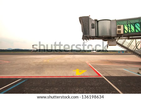 Jetway waiting for a plane to arrive on airport - stock photo